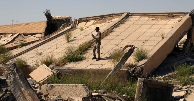 Saddam's tomb suffers extensive damage in Iraq fighting