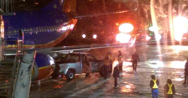 Truck strikes empty Southwest jet at Boston's Logan airport