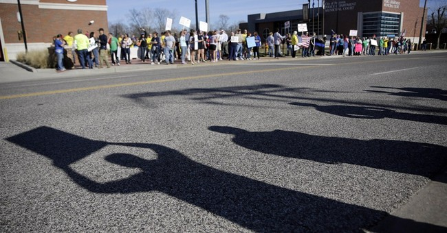 Ferguson police shooting suspect returns to court
