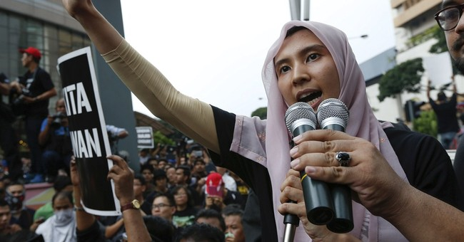 Malaysian police arrest daughter of jailed opposition leader
