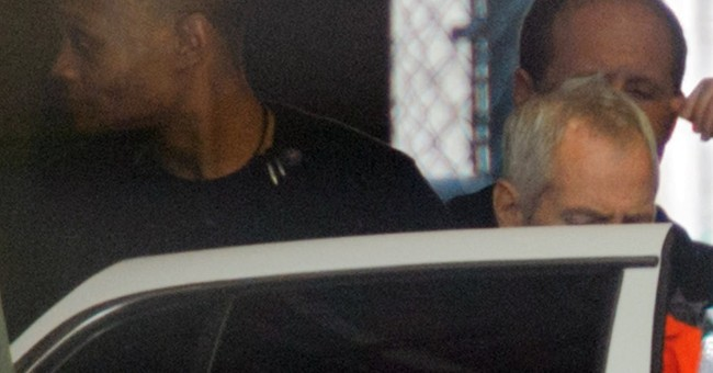 Police carry 2 boxes from home of millionaire Robert Durst