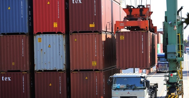 Japan trade gap narrows as lower oil prices reduce imports