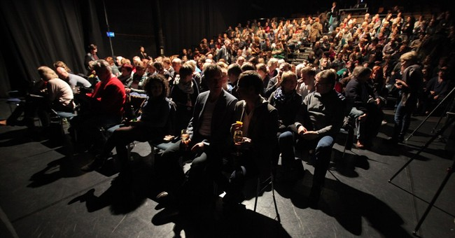 German reporters with foreign roots fight racism in theater