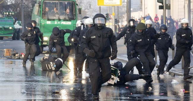 Police cars torched at anti-austerity protest in Germany