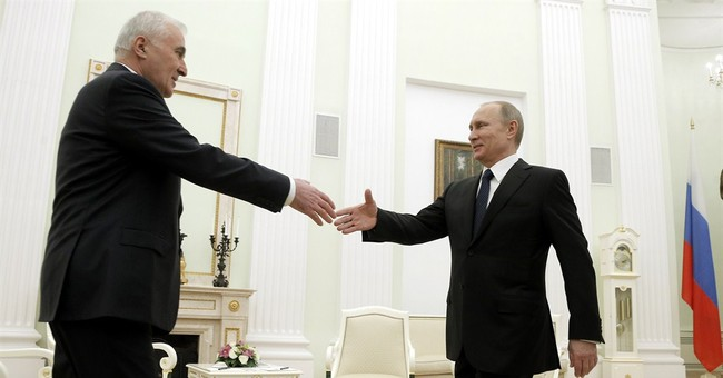 Putin signs treaty integrating South Ossetia into Russia