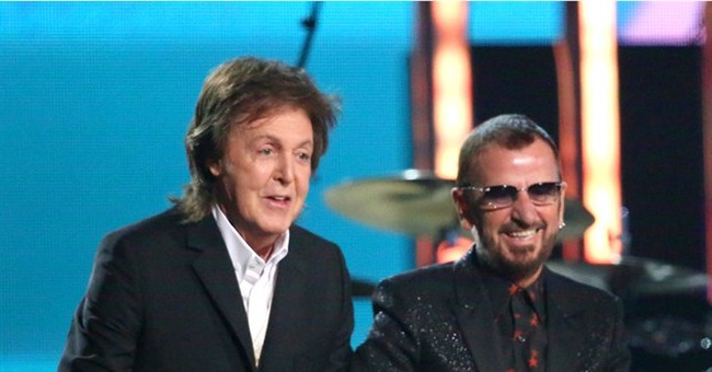 Fellow Beatle McCartney ushering Ringo into rock hall