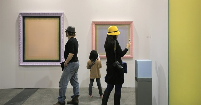 Art, art lovers blur together in images from Hong Kong