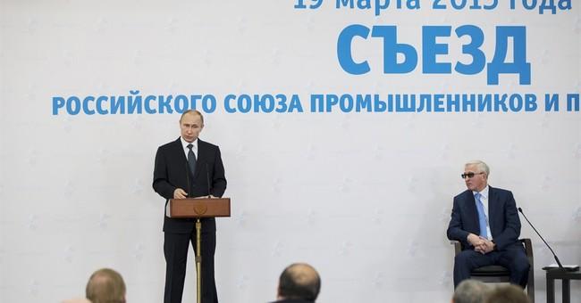 Putin urges billionaires to bring money back to Russia