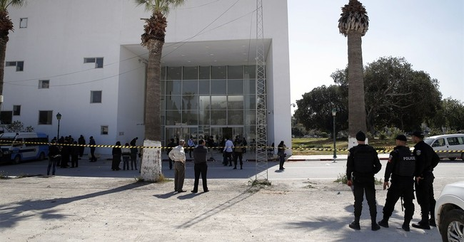 AP Interview: Spanish couple recounts hiding in Tunis museum