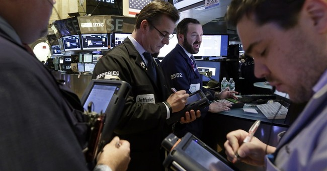Asian markets mostly lower after Wall Street slide