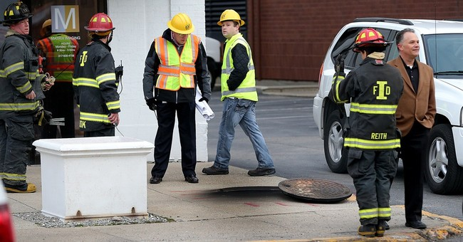 Underground blasts fire Indianapolis manhole covers into air