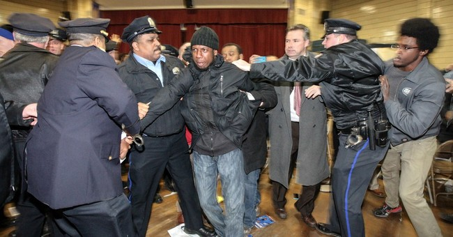 10 arrested after DA says Philly police shooting isn't crime