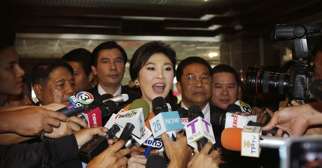 Thai court says ex-premier to stand trial over rice program