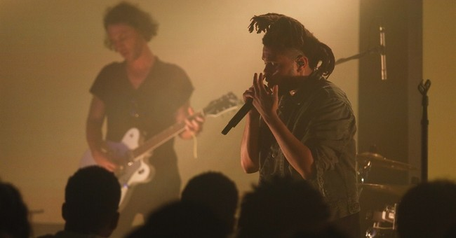 R&B singer The Weeknd, in sultry mood, performs during SXSW