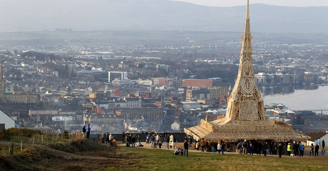 Burning of ornate tower stirs Northern Ireland hearts, minds