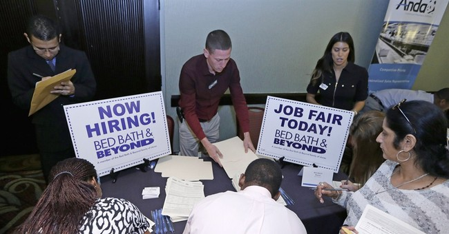 Applications for US jobless aid fall, suggests strong hiring