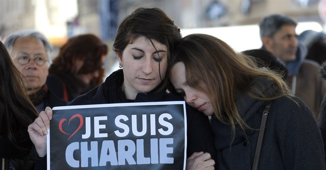 Cartoonists mourn France killings, worry about expression