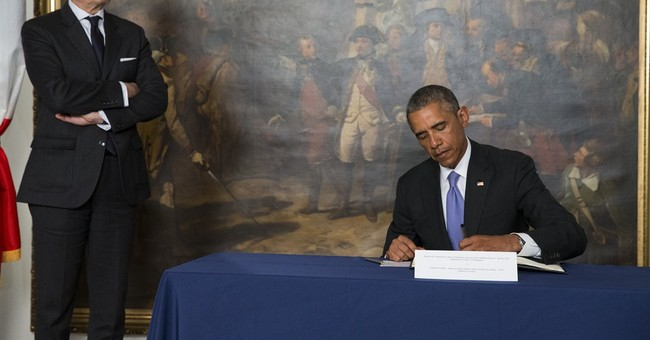 Obama pays respects at French Embassy after Paris attack