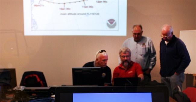 Balloon pilots wait out weather for record attempt