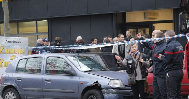 Police officer dies in shooting at Paris' edge, amid tension