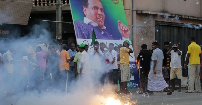 In surprise, Sri Lankans vote in challenger to president