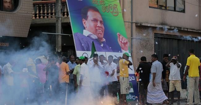 In surprise, Sri Lankans vote in challenger to president