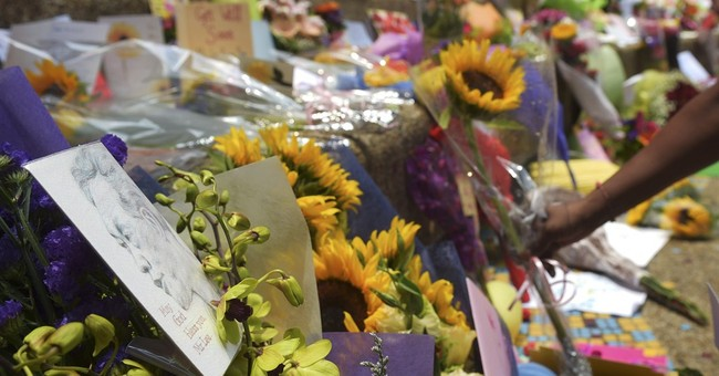Singaporeans leave flowers, cards as Lee's health worsens
