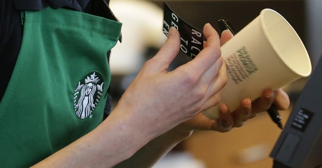 Starbucks baristas stop writing 'Race Together' on cups