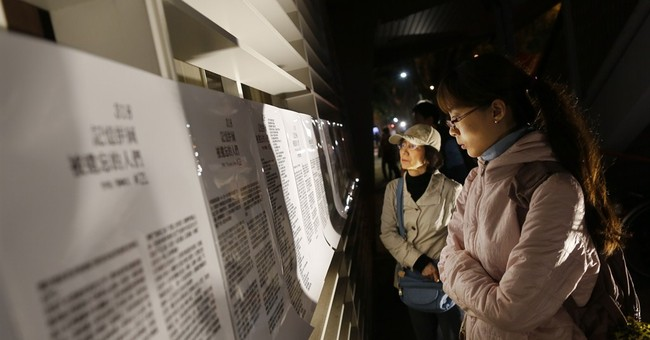Taiwanese mark anniversary of occupy parliament movement