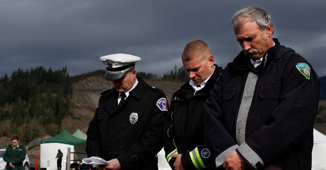 Bell tolls, names read to honor victims of Washington slide