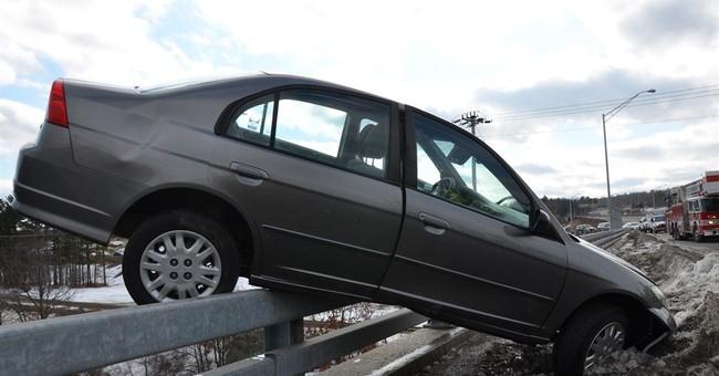 Teen escapes car hanging off bridge over river