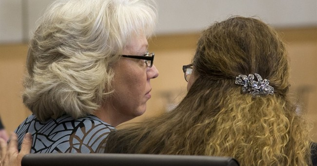 After 22 years on death row, woman sees murder case tossed