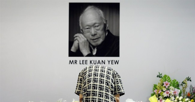Image of Asia: Bowing in respect to late Singapore founder