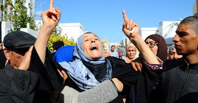 Tunisian prime minister fires security chiefs after attack