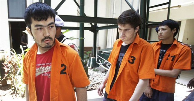 Indonesia tries 4 Chinese Uighurs charged in terrorism case