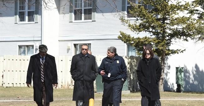 Detroit woman arrested after 2 kids found dead in freezer