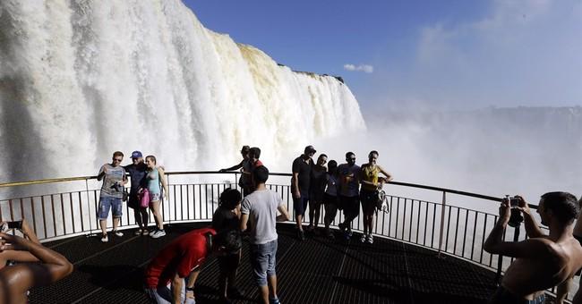 AP PHOTOS: Tourists enjoy South America's Iguazu Falls