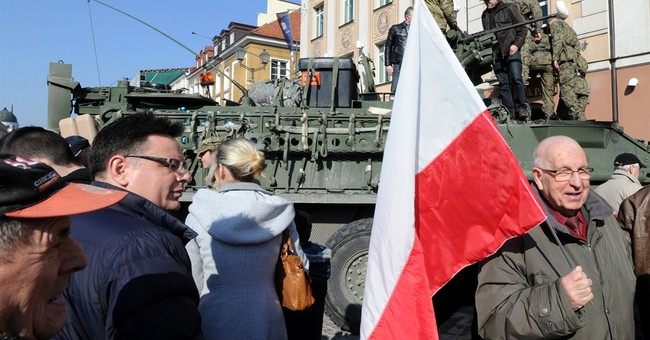 US troops driving through Poland get warm welcome