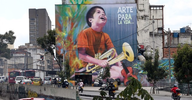 Graffiti boom born in tragedy brightens up Colombia capital