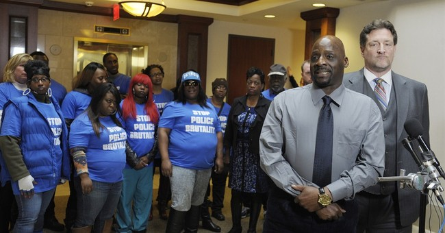 Leaders urge patience in Detroit-area police beating probe