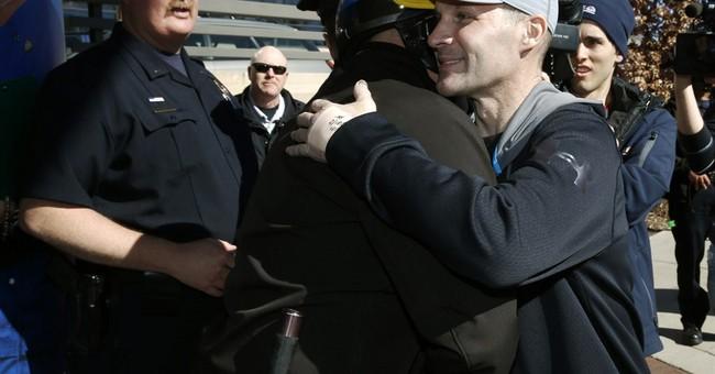 Man who crashed into Denver cop at protest held on $50K bond