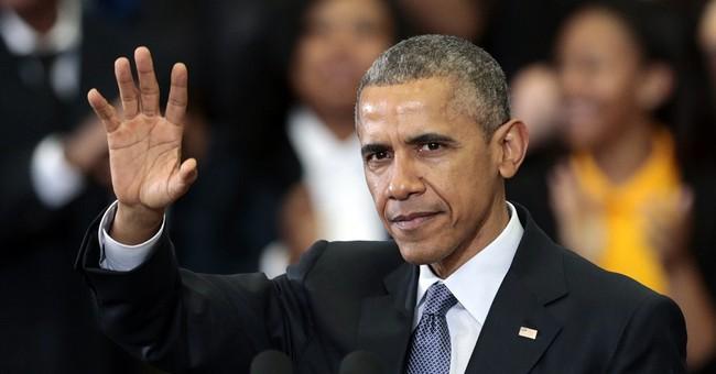 Obama praises payday lender rules, vows veto of limitations