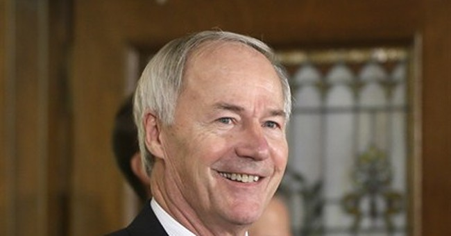 Arkansas governor says he'd sign religious protection bill