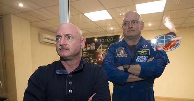 Astronauts board space station for 1-year mission