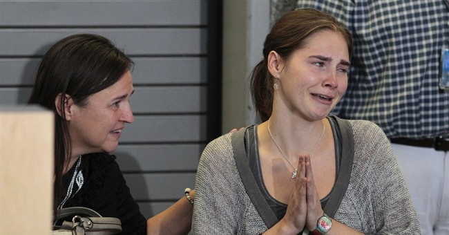 Marriage plans and writing occupy Amanda Knox