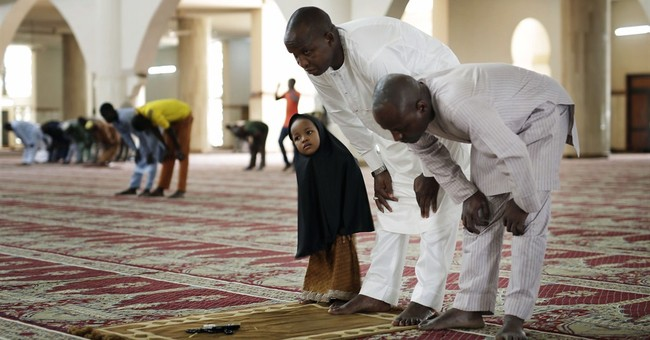 Nigerian leader urges peaceful vote as elections loom
