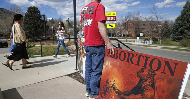 Fetus debate looms following charges in womb-cutting case