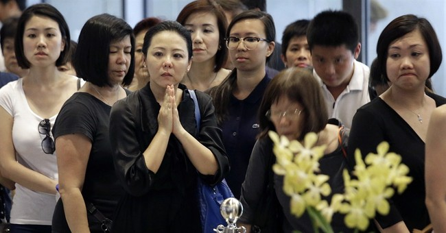 Singapore urges restraint as Lee mourners queue for 10 hours