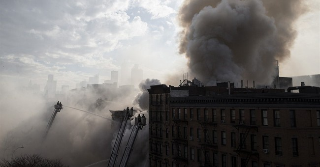 AP PHOTOS: NYC firefighters battle huge fire after explosion