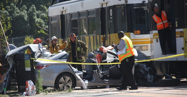 LA light rail train hits car, partially derails; 21 hurt